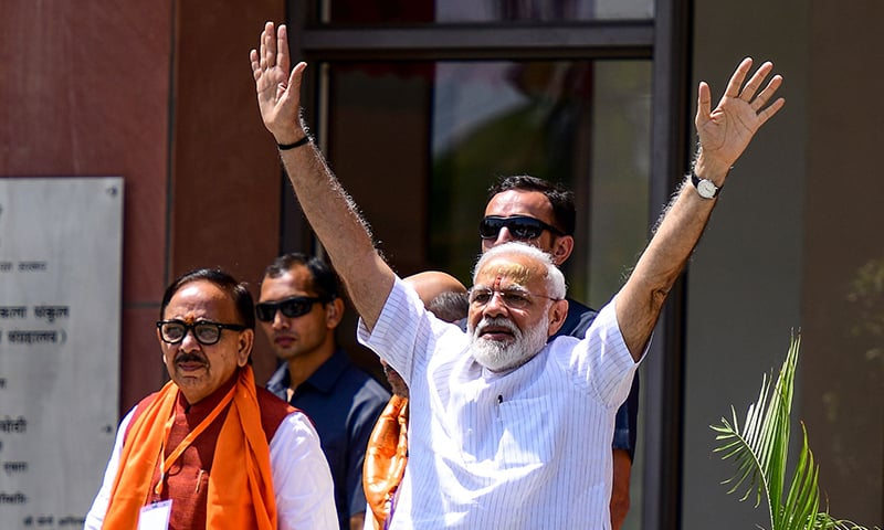 Indian Prime Minister Narendra Modi waves to supporters at the Trade Facilitation Centre and Crafts Museum after offering prayers at the famous Kashi Vishwanath temple, in Varanasi on May 27. — AFP