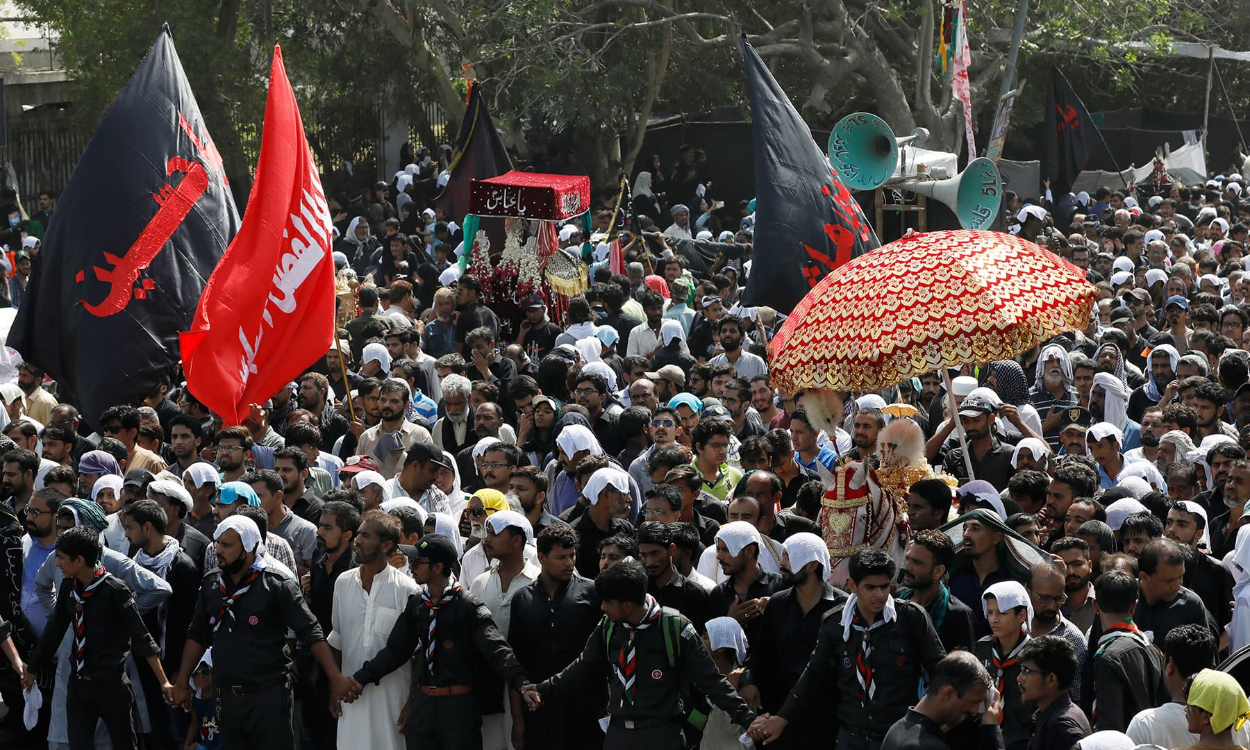 Shia Muslims take part in the religious procession of Youm-i-Ali in Karachi. — Reuters