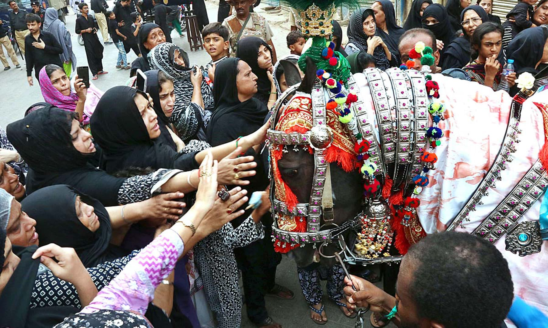 A large number of people attend a Youm-i-Ali procession in Saddar area of Hyderabad. — APP