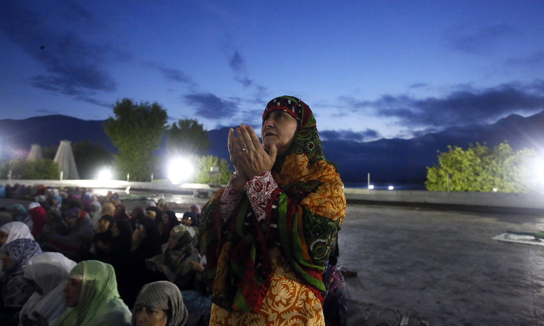 Kashmiri Muslim devotees pray early in the morning at the Hazratbal shrine, during special prayers to observe the martyrdom of Hazrat Ali in Srinagar, Monday. — AP