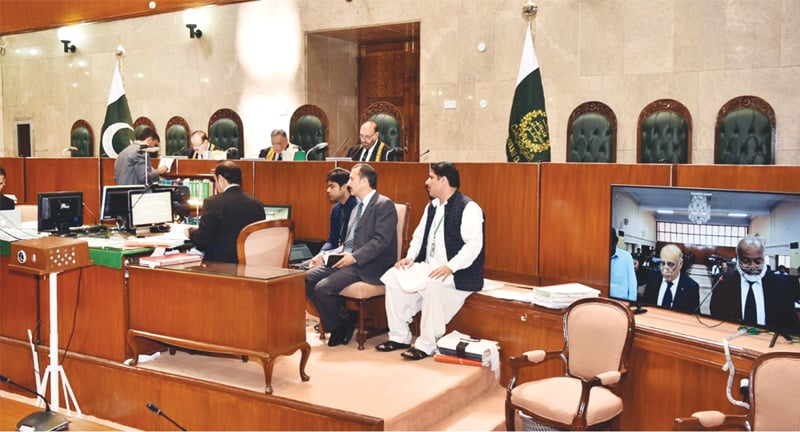 ISLAMABAD: A three-member bench headed by Chief Justice of Pakistan Asif Saeed Khosa hearing cases through video link on Monday as the e-court system of the Supreme Court becomes functional.—White Star