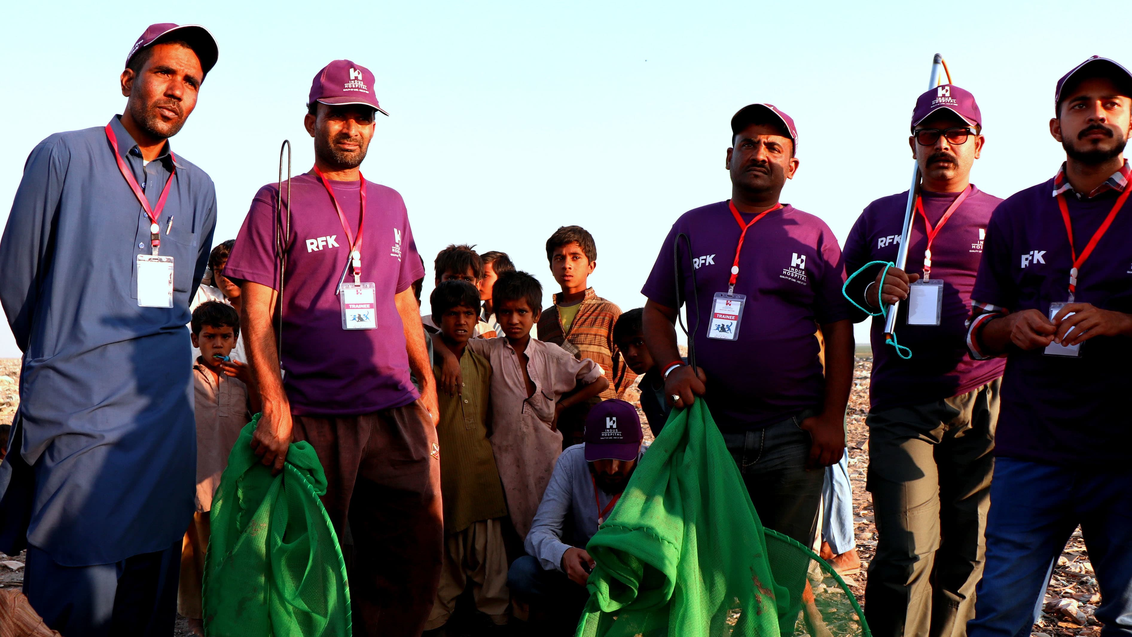 RFK workers on the field with dog catching equipment at Korangi Industrial Area.—*Courtesy TIH*