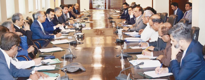 ISLAMABAD: Finance Adviser Dr Abdul Hafeez Shaikh chairing a meeting of foreign exchange dealers on Tuesday.
