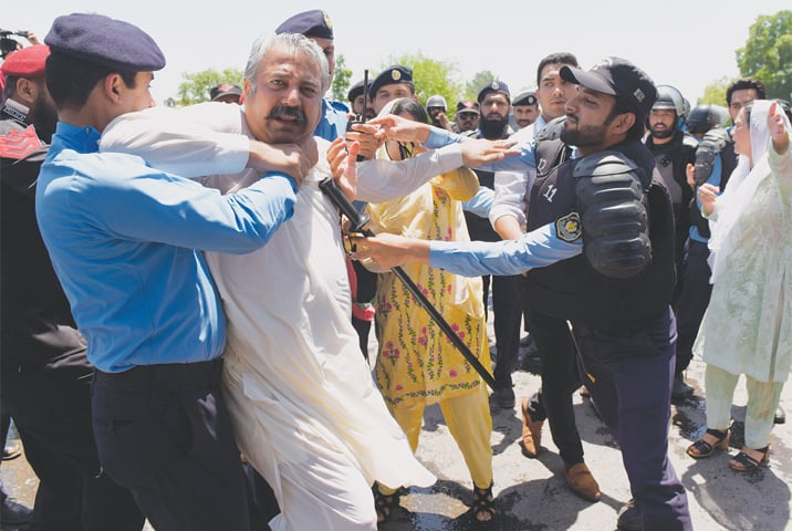 ISLAMABAD: Security personnel rough up some members of the Pakistan Peoples Party as they arrest them on Wednesday.—Tanveer Shahzad / White Star