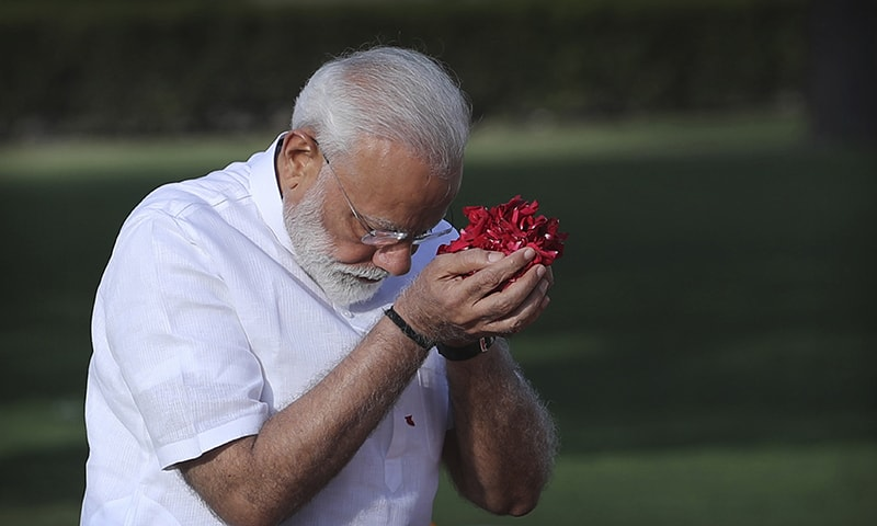 Indian Prime Minister Narendra Modi pays tributes at Rajghat, the memorial to Mahatma Gandhi, before being sworn in for his second term as Indian prime minister today evening in New Delhi. ─ AP