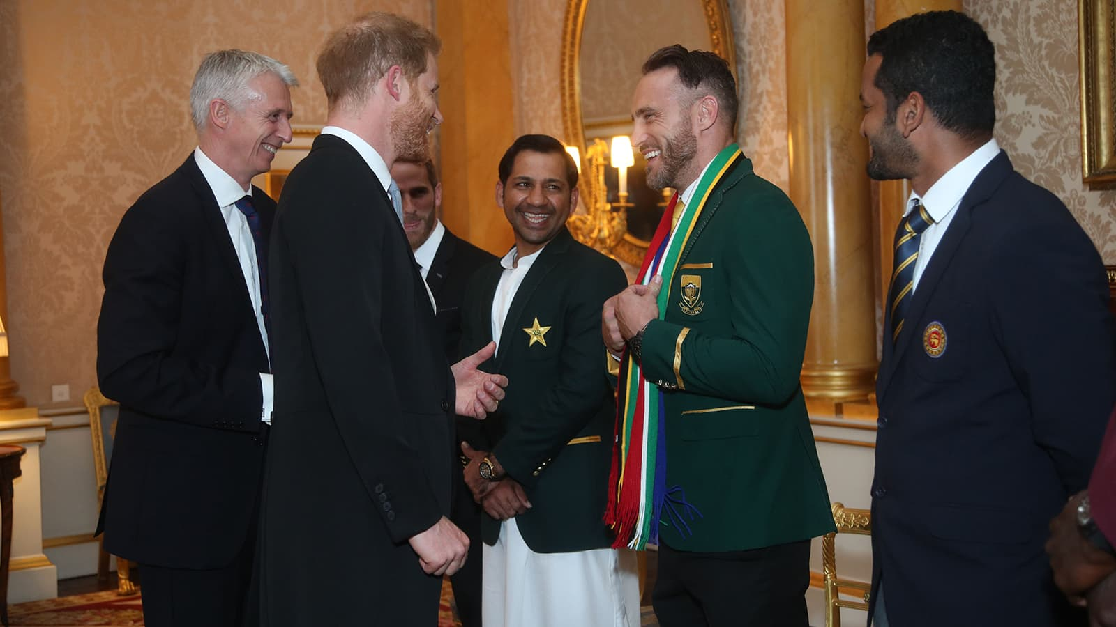 Britain's Prince Harry, Duke of Sussex chats to South Africa's captain Faf du Plessis, (C), Pakistan's captain Sarfaraz Ahmed (L) and Sri Lanka's captain Dimuth Karunaratne (R) during a meeting with the captains of the cricket teams participating in the World Cup 2019, in the 1844 Room at Buckingham Palace, London on May 29. — AFP