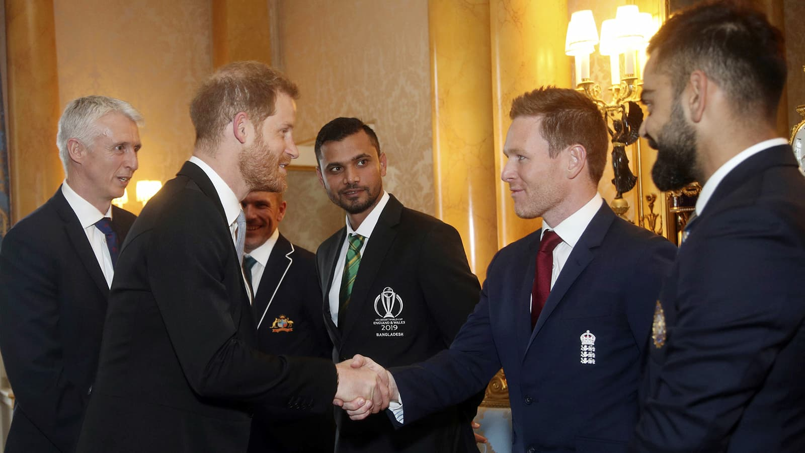 Britain's Prince Harry meets England cricket captain Eoin Morgan, second right, Australia captain Aaron Finch, second left, Bangladesh captain Masrafe Bin Mortaza, centre, and India captain Virat Kohli during a Royal Garden Party at Buckingham Palace in London on May 29. — AP