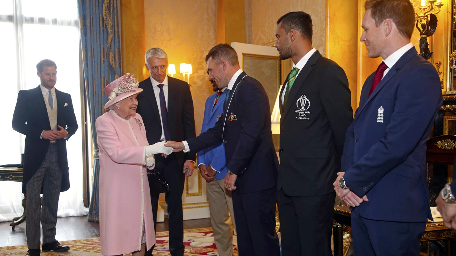 Britain's Queen Elizabeth meets, from left, Afghanistan cricket captain Gulbadin Naib, Australia captain Aaron Finch, Bangladesh captain Masrafe Bin Mortaza and England captain Eoin Morgan during a Royal Garden Party at Buckingham Palace in London on May 29. — AP