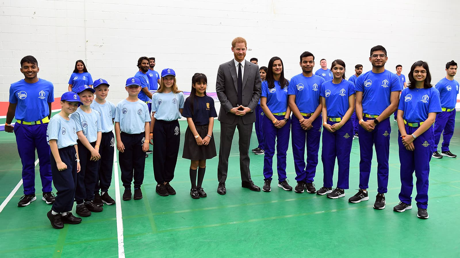 Britain's Prince Harry, Duke of Sussex poses with children as he attends the opening match of the World Cup 2019 between England and South Africa at The Oval in London on May 30. — Reuters