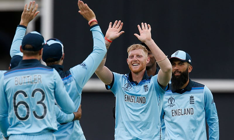 England's Ben Stokes (C) celebrates with teammates after taking the last wicket of South Africa's Imran Tahir and England win by 104 runs in the 2019 Cricket World Cup group stage match between England and South Africa. — AFP