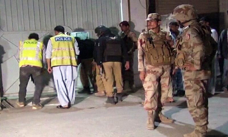 Rangers and police officials are pictured at the crime scene in Quetta's Mecongi road area. — DawnNewsTV