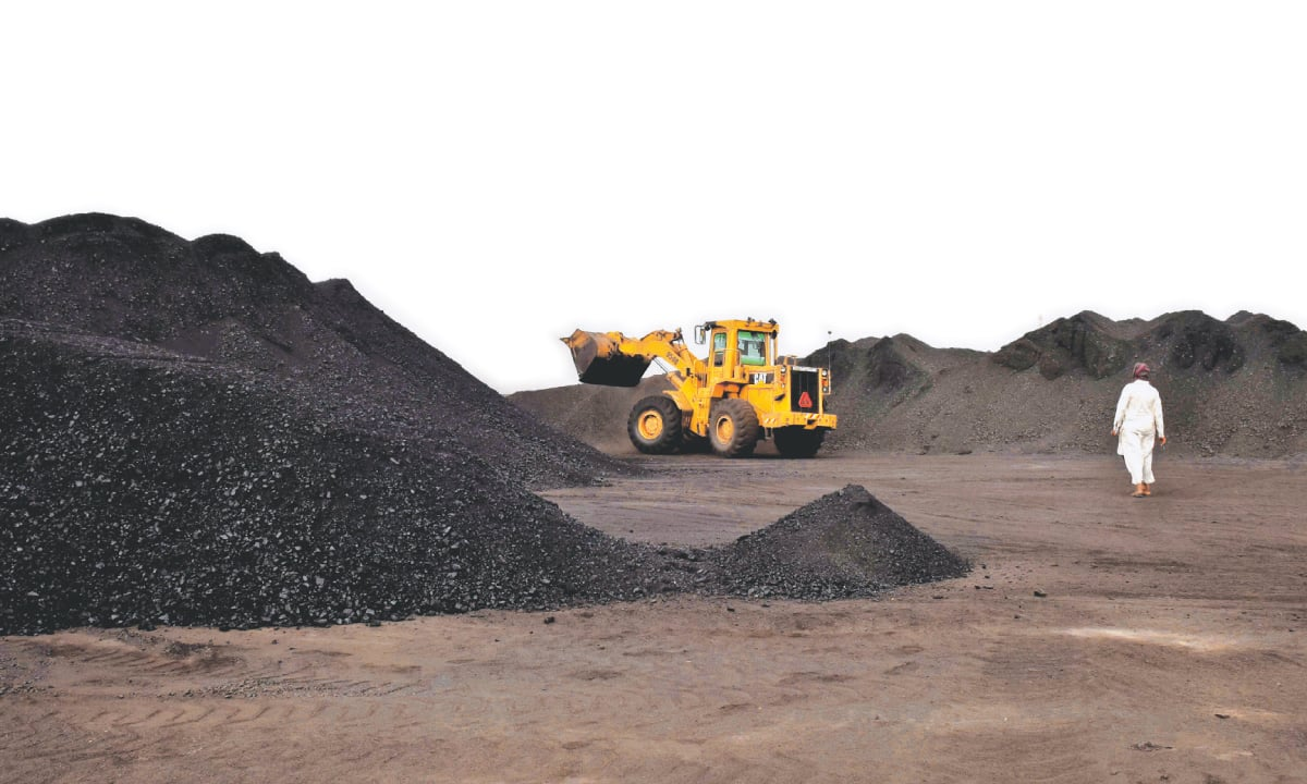 Coal being unloaded from a truck in Landhi, Karachi | Fahim Siddiqui, White Star