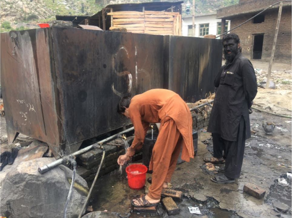 Miners in Darra Adam Khel wash themselves | Photo by Aurangzaib Khan