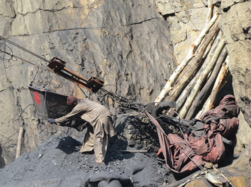 A miner at work in Darra Adam Khel | Photo by Aurangzaib Khan