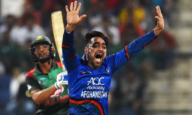 In this file photo taken on September 20, 2018 Afghan cricketer Rashid Khan appeals for an unsuccessful leg before wicket (LBW) decision against Bangladesh batsman Mohammad Mahmudullah during the Asia Cup ODI at The Sheikh Zayed Stadium in Abu Dhabi. ─ AFP