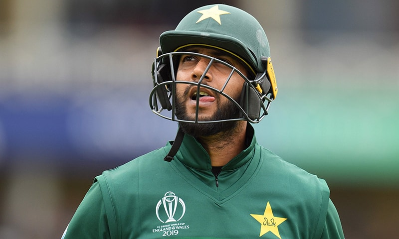 Pakistan's Imad Wasim walks back to the pavilion after getting out for 1 run during the 2019 Cricket World Cup group stage match between West Indies and Pakistan at Trent Bridge in Nottingham, central England, on May 31. — AFP