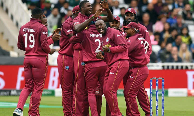 West Indies players including Andre Russell (3R) and captain Jason Holder (4L) celebrate taking the wicket of Pakistan captain Sarfaraz Ahmed during the 2019 Cricket World Cup group stage match between West Indies and Pakistan at Trent Bridge in Nottingham, central England, on Friday. — AFP