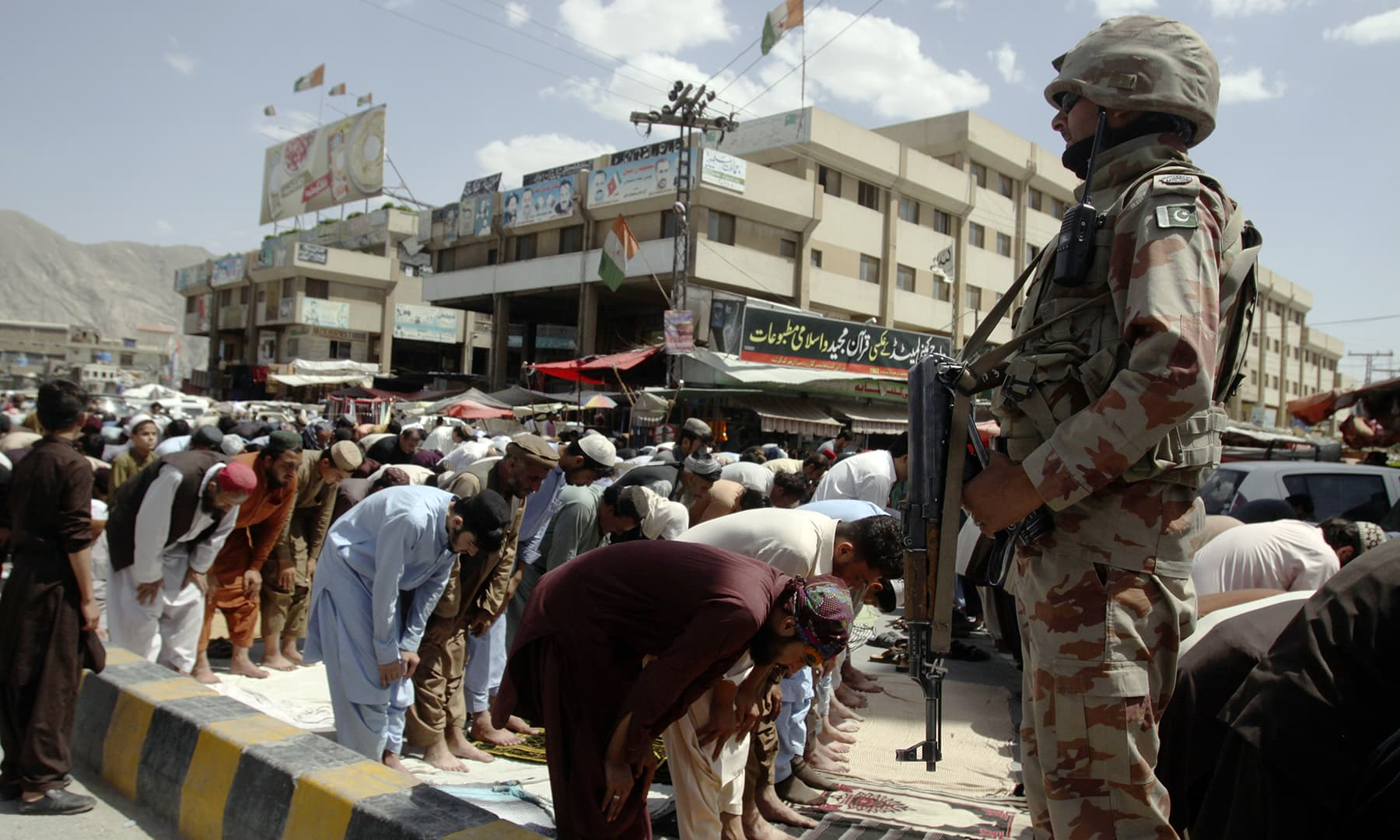 Worshippers offer prayers during Jumatul Wida under tight security in Quetta on Friday. — AP