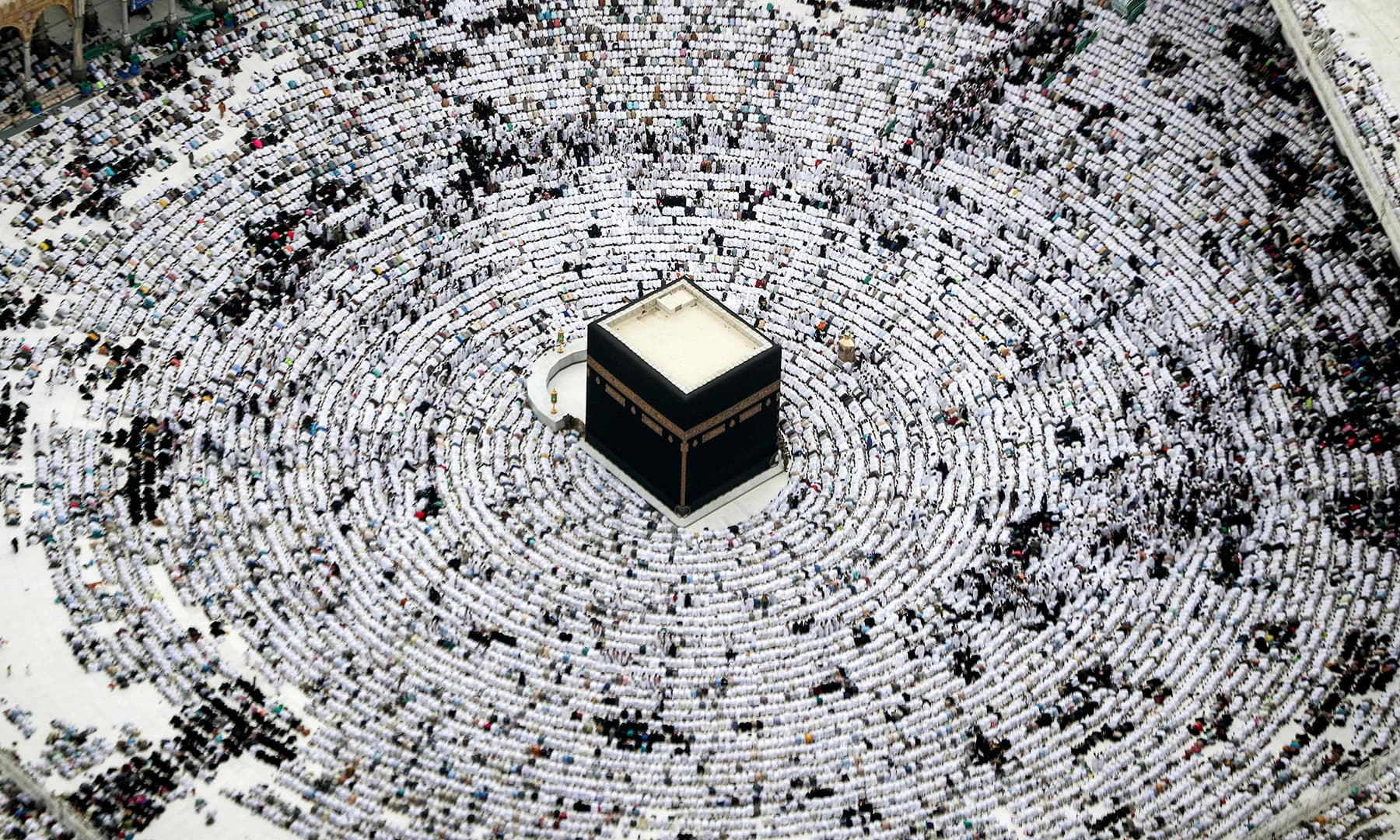 This picture taken on May 31 shows an aerial view of worshippers prostrating during prayer around the Holy Kaaba at the Grand Mosque in Saudi Arabia's holy city of Makkah. — AFP
