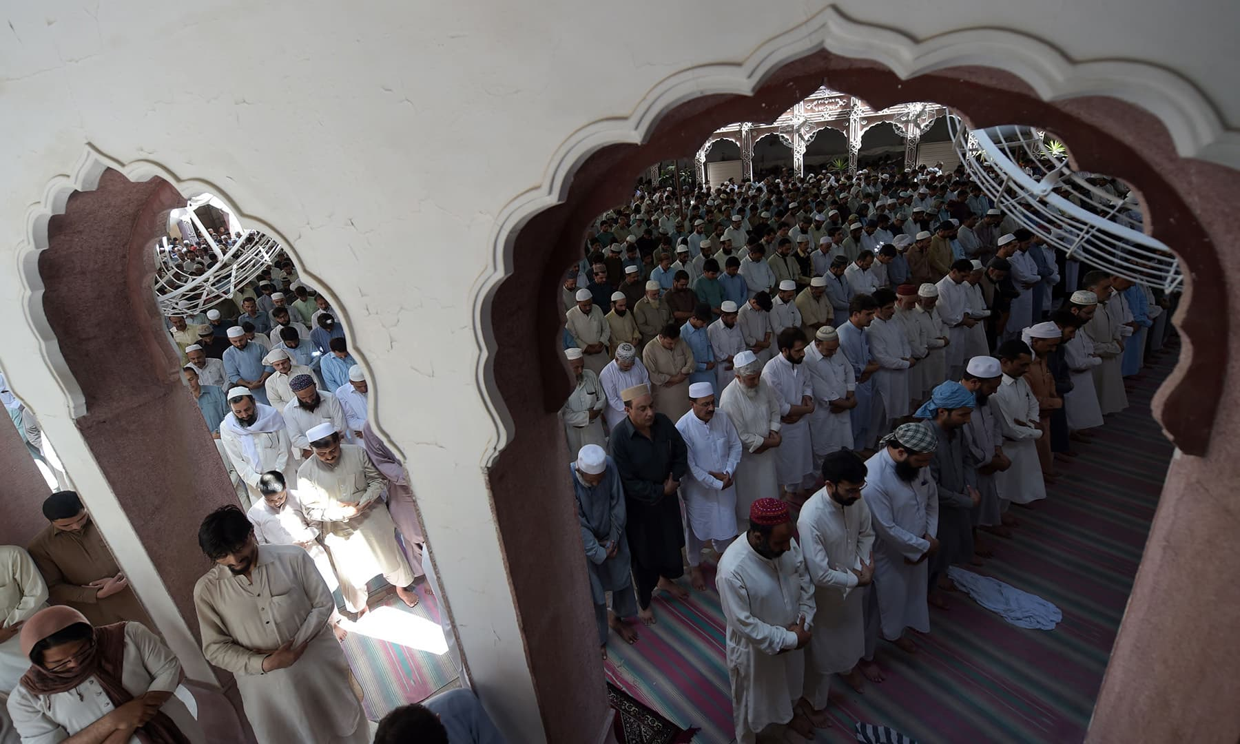 People offer Jumatul Wida prayers on the last Friday of Ramazan at a mosque in Peshawar on May 31. — AFP