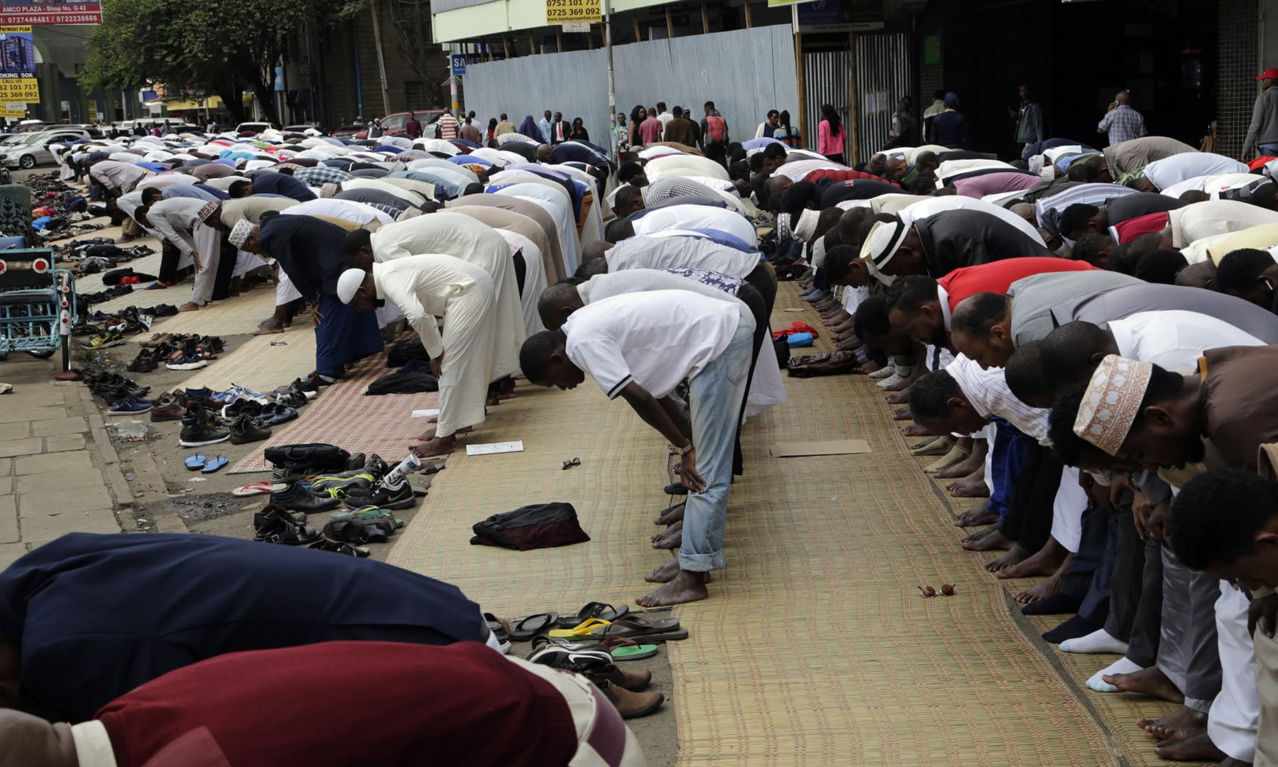 Kenyan Muslims offer prayers on the last Friday of Ramazan at Jamia mosque in Nairobi, Kenya. — AP