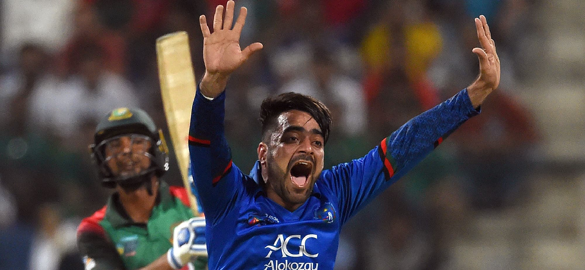 "(FILES) In this file photo taken on September 20, 2018 Afghan cricketer Rashid Khan appeals for an unsuccessful leg before wicket (LBW) decision against Bangladesh batsman Mohammad Mahmudullah during the one day international (ODI) Asia Cup cricket match between Bangladesh and Afghanistan at The Sheikh Zayed Stadium in Abu Dhabi. - Groomed on dusty pitches as a refugee, record-breaking Rashid Khan will face his toughest examination yet at the World Cup with former coaches confident the Afghan can ""dismantle"" the cricket's best batsmen. (Photo by ISHARA S. KODIKARA / AFP) — AFP or licensors"
