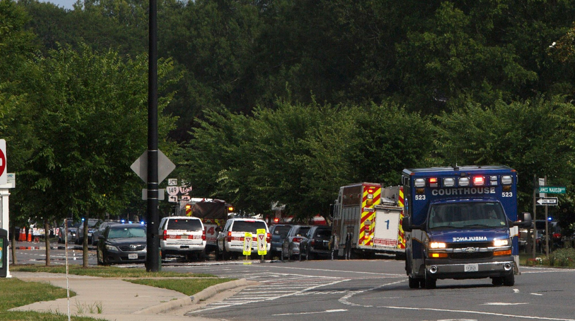 Emergency vehicle are seen near the intersection of Princess Anne Road and Nimmo Parkway following a shooting at the Virginia Beach Municipal Center on Friday in Virginia Beach. — AP