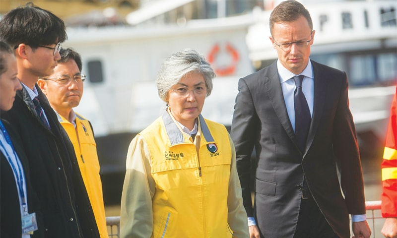 Budapest: South Korean Foreign Minister Kang Kyung-wha (centre) and her Hungarian counterpart Peter Szijjarto visit the scene of the boat accident on Friday.—AP