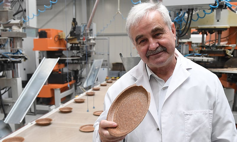 Polish inventor and entrepreneur Jerzy Wysocki holds a wheat bran plate in his factory Biotrem in Zambrow, Poland on May 29. — AFP