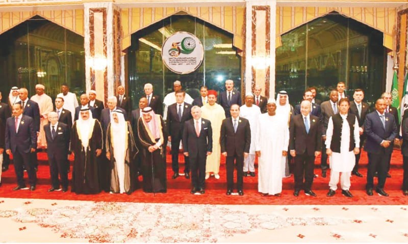 PRIME Minister Imran Khan in a group photo with the leaders of OIC member countries at the summit in Makkah on Saturday.