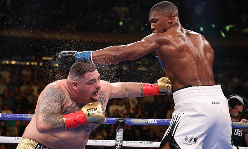 Anthony Joshua knocks down Andy Ruiz Jr in the third round during their IBF/WBA/WBO heavyweight title fight at Madison Square Garden on June 01, 2019 in New York City. ─ AFP