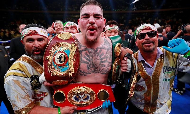 Andy Ruiz Jr celebrates winning the fight with his team. ─ Reuters