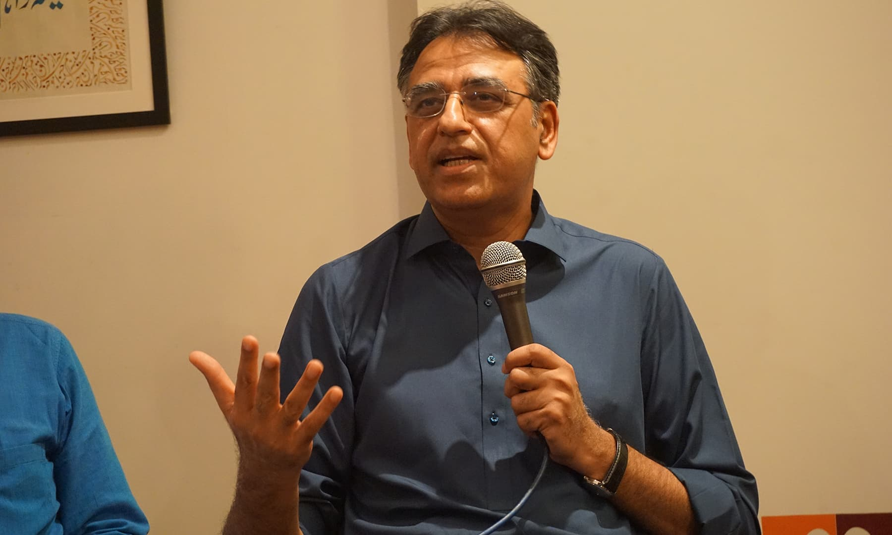 Asad Umar defending the economic decisions taken by the government in the past ten months. — Photo by author