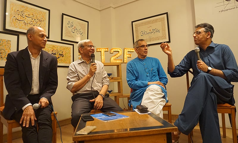 (L-R): Khurram Hussain, Kaiser Bengali, Akbar Zaidi and Asad Umar, discussing the economic future of Pakistan at an event in Karachi on June 2. — Photo by author