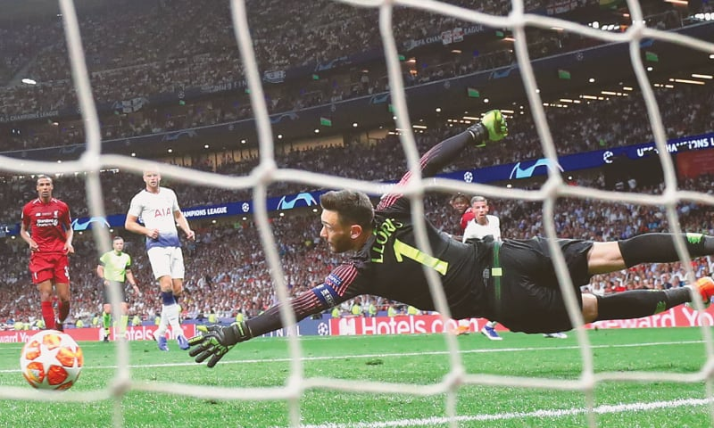 MADRID: Liverpool's Divock Origi (second R, obscured) scores past Tottenham Hotspur goalkeeper Hugo Lloris during the UEFA Champions League final at the Wanda Metropolitano.—Reuters