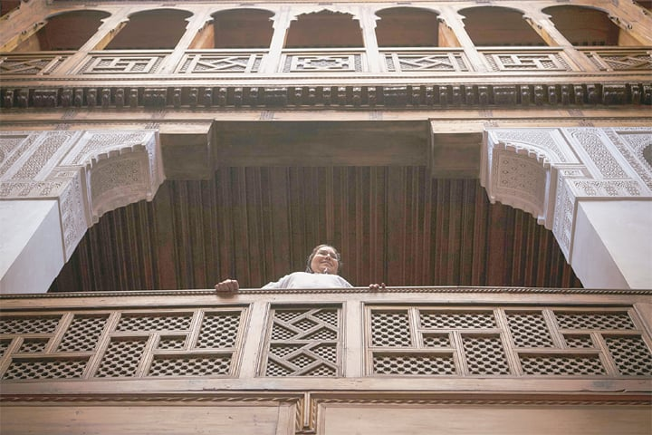Fez: A woman stands in the balcony of an old building in the ninth century walled quarter of this ancient city.—AFP
