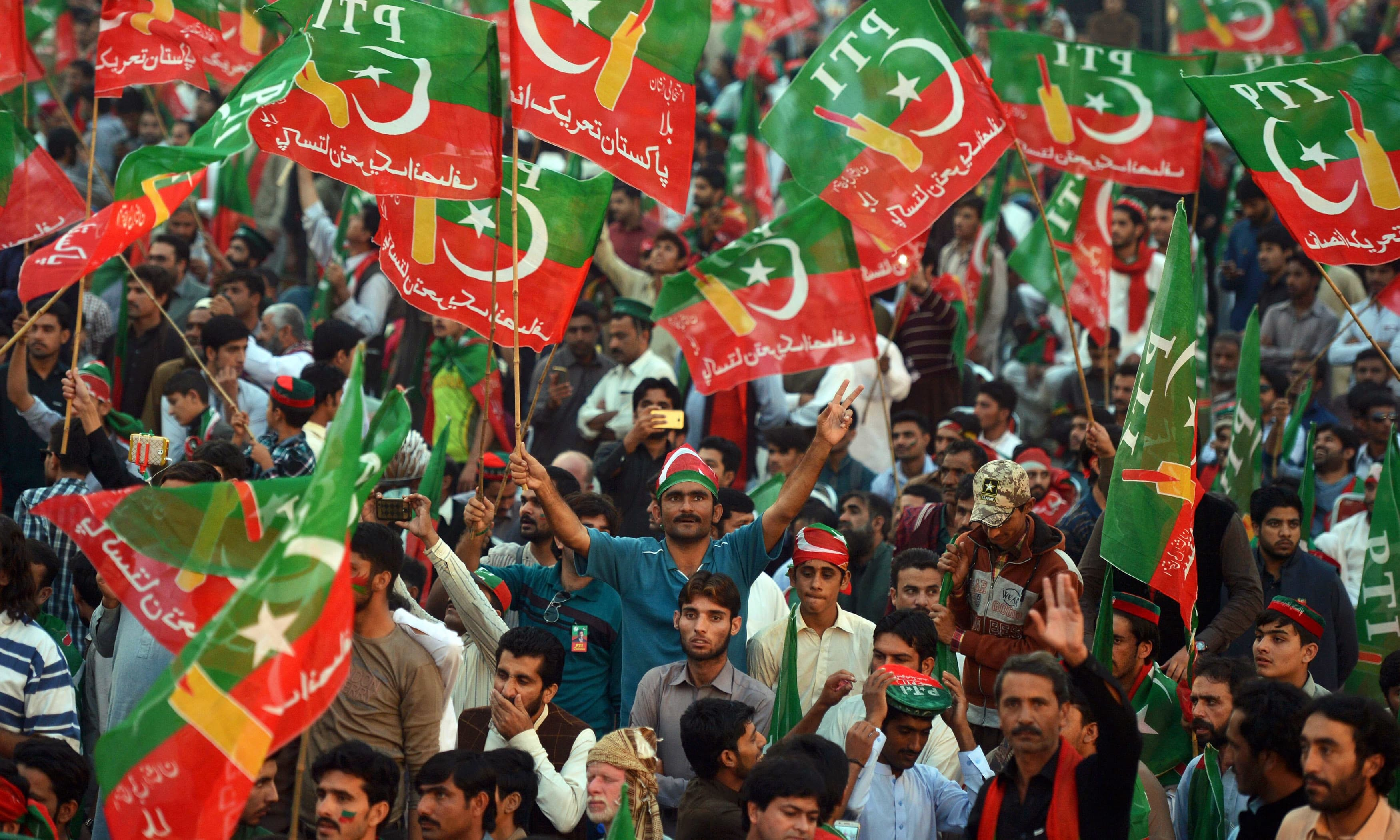 PTI dissolves all its wings before restructuring