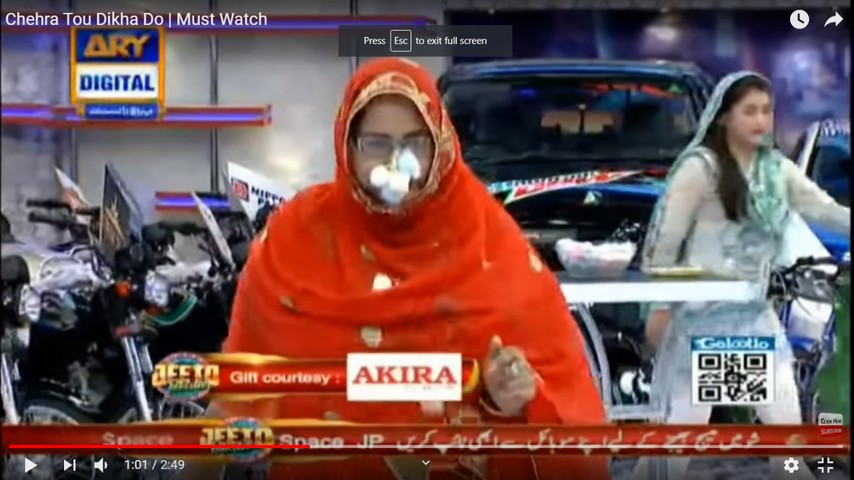 A competition in which women have to stick cotton balls to their faces using butter and run across the room.