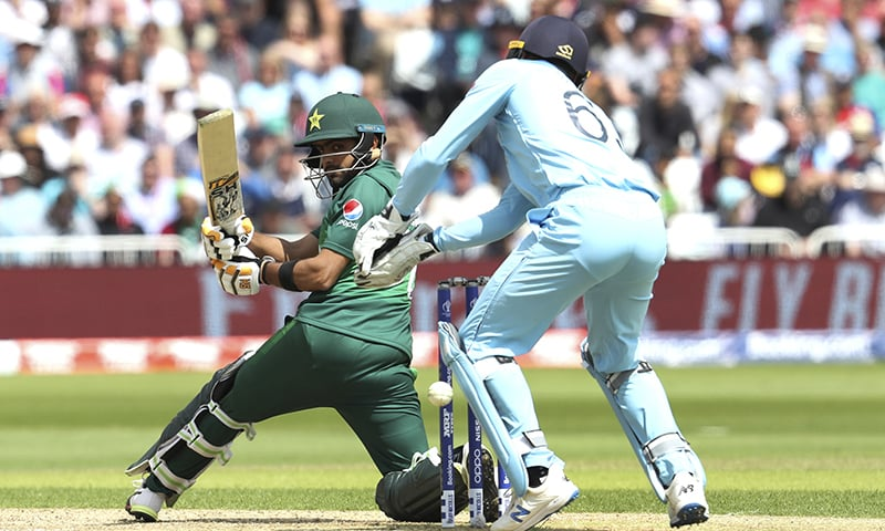 Babar Azam, left, plays a shot during the Cricket World Cup match between England and Pakistan at Trent Bridge. — AP