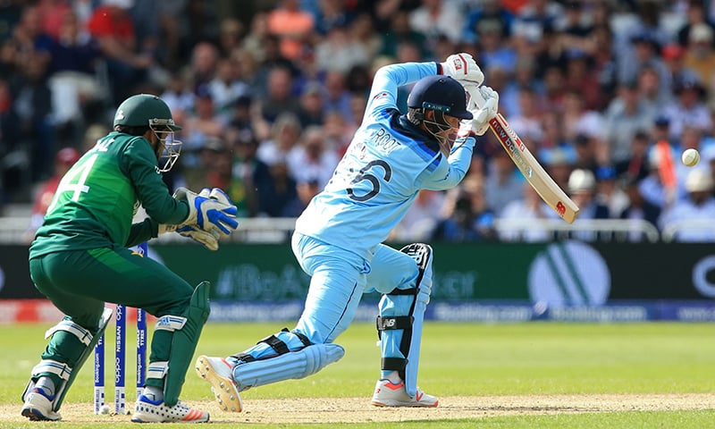 England's Joe Root (R) plays a shot as Pakistan's captain Sarfaraz Ahmed (L) keeps wicket during the 2019 Cricket World Cup group stage match between England and Pakistan at Trent Bridge in Nottingham, central England, on June 3. — AFP