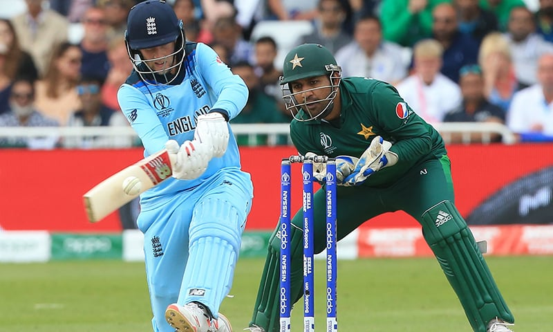 England's Joe Root (L) plays a shot as Pakistan's captain Sarfaraz Ahmed (R) keeps wicket during the 2019 Cricket World Cup group stage match between England and Pakistan. — AFP