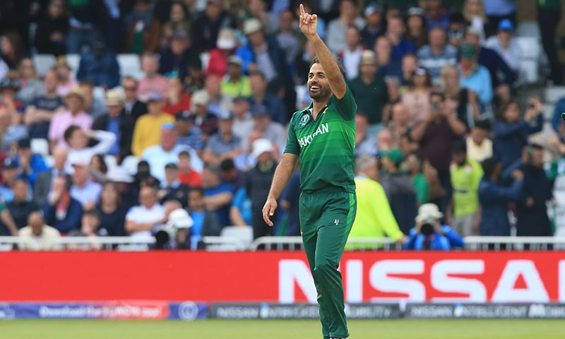 Wahab Riaz celebrates after taking the wicket of England's Chris Woakes during the 2019 Cricket World Cup group stage match between England and Pakistan. — AFP