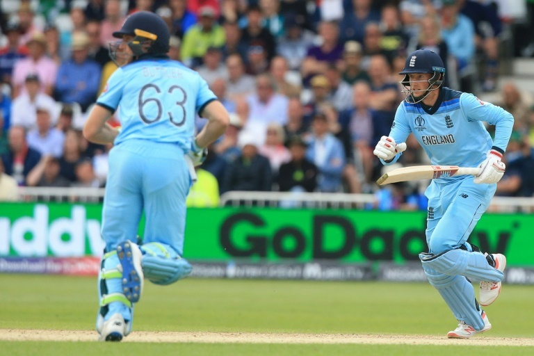 Joe Root (right) and Jos Buttler both scored centuries in England's World Cup defeat by Pakistan. — AFP