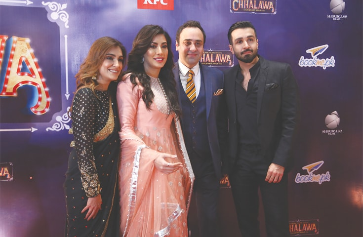 WAJAHAT Rauf flanked by the lead pair of the film Mehwish Hayat and Azfar Rehman.