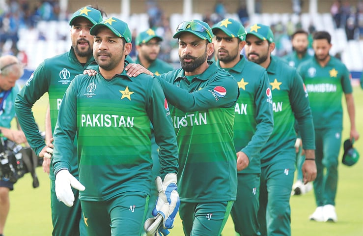 NOTTINGHAM: Sarfraz Ahmed leads his team off the pitch after Pakistan won their World Cup match against England at Trent Bridge on Monday.—AFP