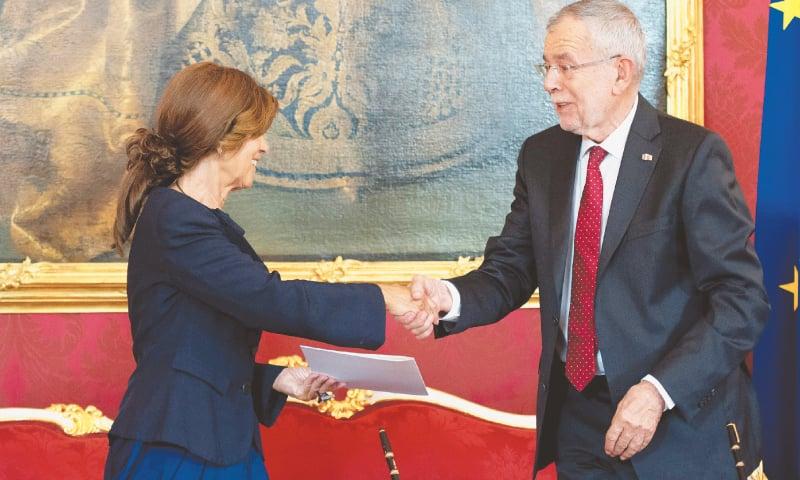 Vienna: Austrian President Alexander Van der Bellen (right) in a handshake with Briggite Bierlein, who heads the country's constitutional court, after appointing her as interim chancellor on Monday. — AFP