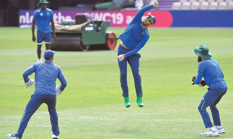 SOUTHAMPTON: South African captain Faf du Plessis (C) goes airborne to take a catch during a training session at the Rose Bowl on Tuesday.—AFP