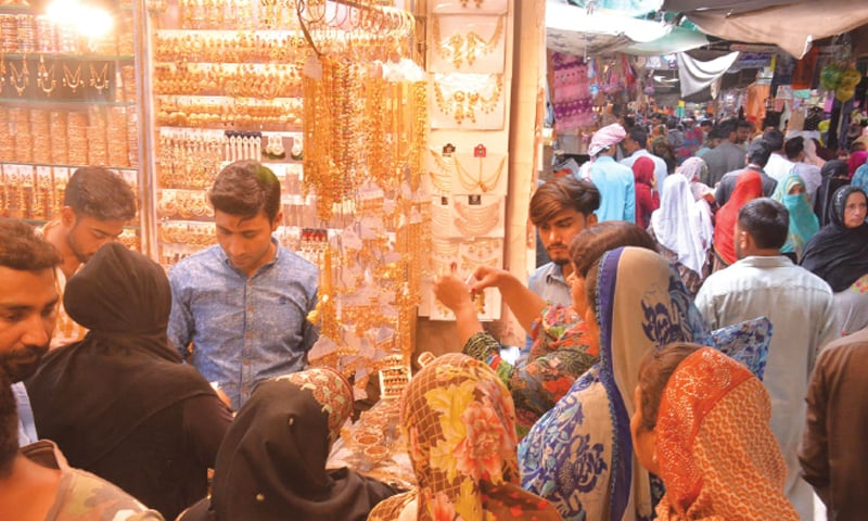 FAISALABAD: Women are buying jewellery in Anarkali Bazaar on the eve of Eidul Fitr on Tuesday. According to traders, prices of local items have surged by 20-25pc while those of imported goods by 30-40pc having adverse impact on the overall Eid sales. — Online
