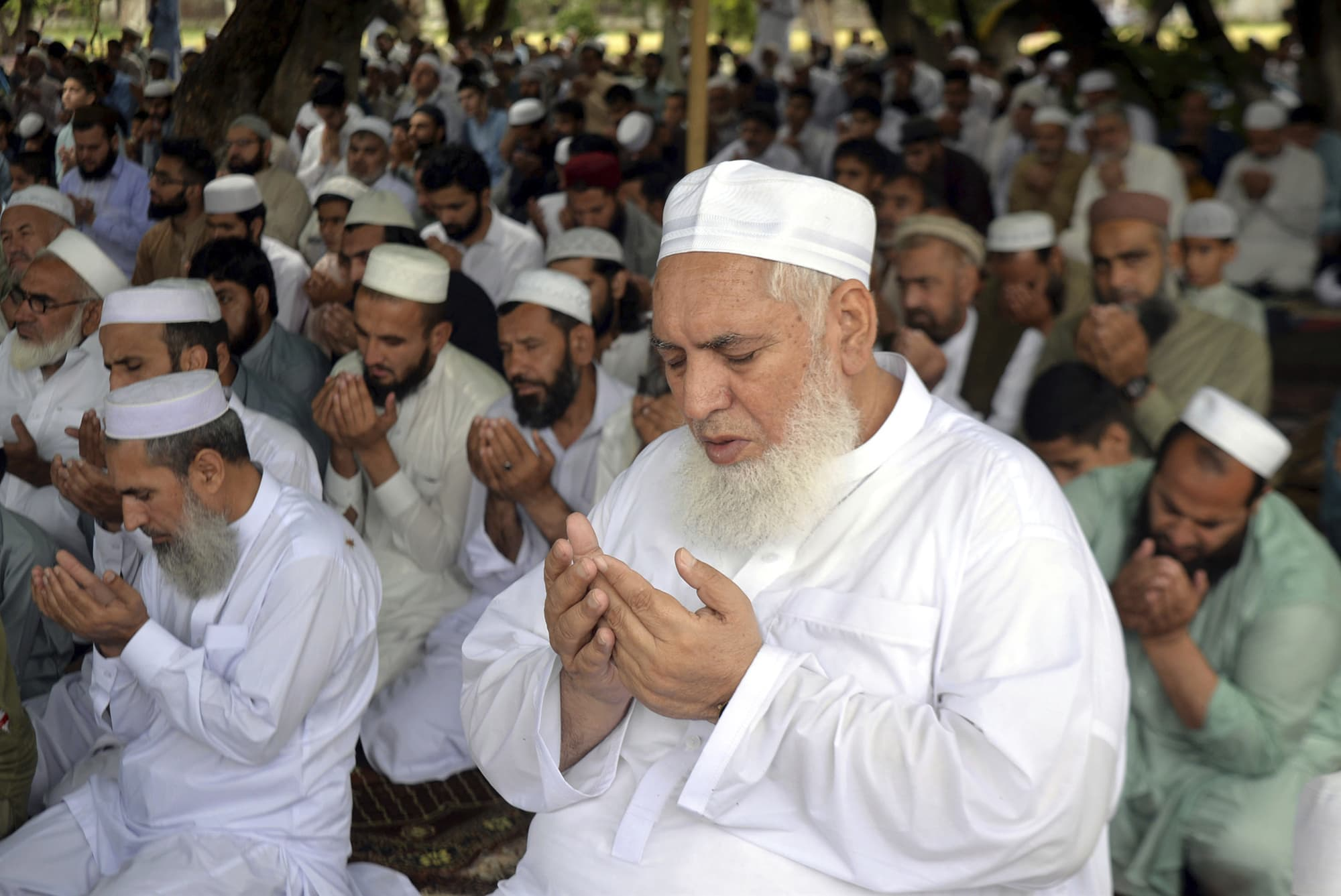 Eid prayers offered in Peshawar on Tuesday. — AP