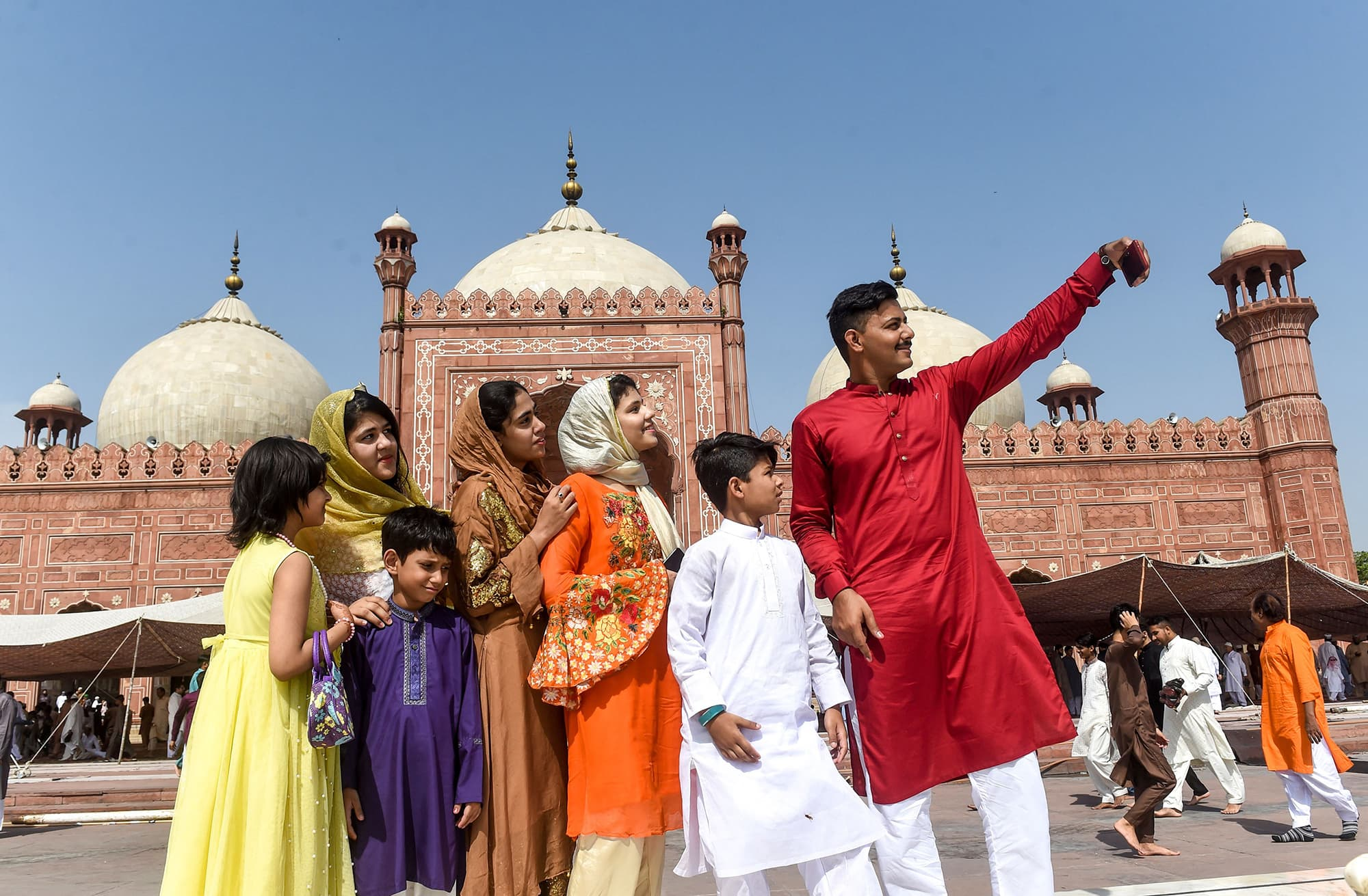A family takes a selfie after offering prayers at the Badshahi Mosque in Lahore. — AFP